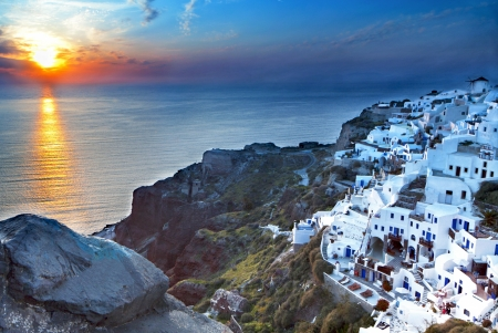santorini: Santorini island in Greece during sunset hour Stock Photo