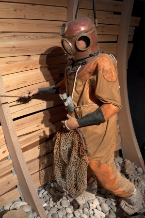 kreta: Old diver doll in a museum Stock Photo