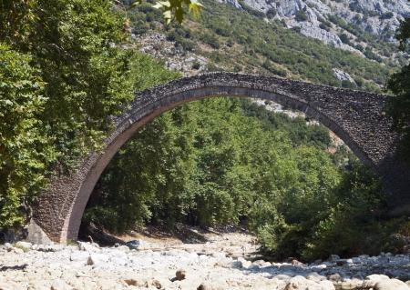pili: Old stone bridge near Trikala city in central Greece Stock Photo