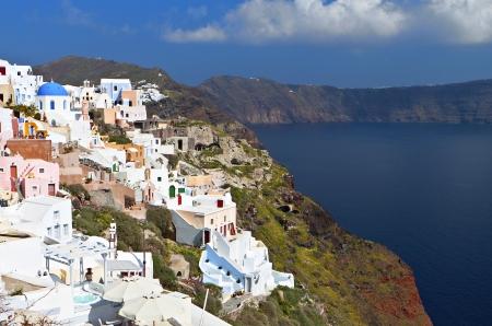 Scenic village of Oia at Santorini island in Greece photo