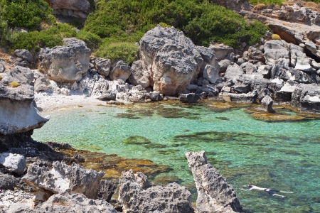 kefalinia: Rocky beach formation at Kefalonia island in Greece Stock Photo