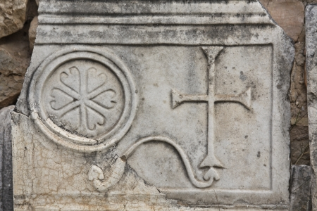templars: Old christian plaque with a cross relief on it Stock Photo