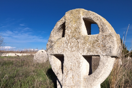 Medieval cemetery with celtic crosses in Europe photo