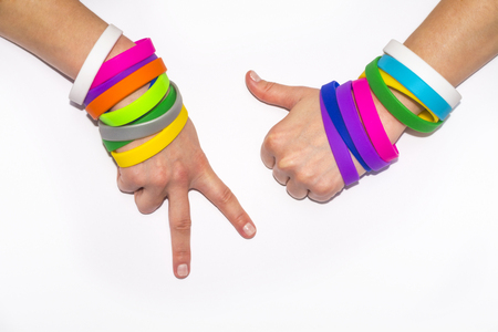 Blank rubber wristbands on wrist arm. Silicone fashion round social bracelet wear on hand. Unity band.