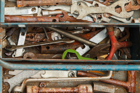 rustiness: Colorful rusty tools in a box