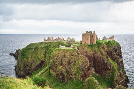 dunnottar castle: Dunnottar Castle near Aberdeen on a cloudy day