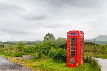 scotish: Lonely telephone box in Scotish Highland scenery Stock Photo