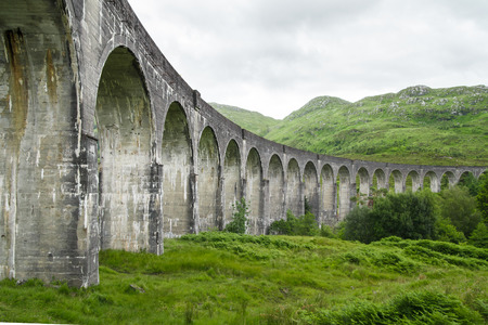 the jacobite: Glenfinnan Viaduct in Scotland surrounded by beautiful landscape Stock Photo