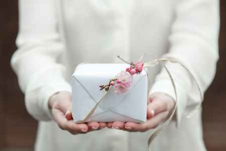 wrapped present: Woman with Wrapped Present Stock Photo