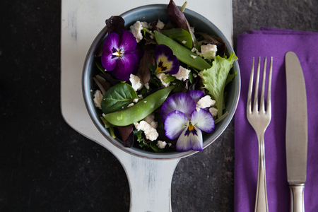 Spring salad with snow peas and edible blossoms
