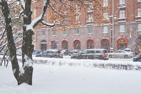 Snowfall in European City. Snow covered street.