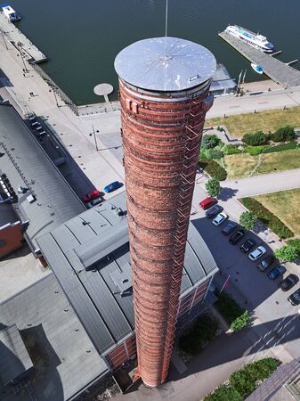 Aerial view of the pipe of an old factory. The pipe is closed and not used. The building of the factory was rebuilt for apartments for students.