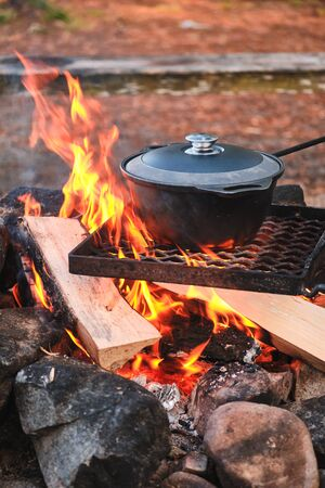 Cooking at the campfire traditional dish.
