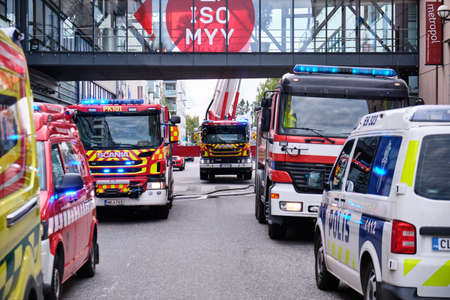 Joensuu, Finland - 8 September 2019: The fire engines and police car near the shopping mall. 報道画像