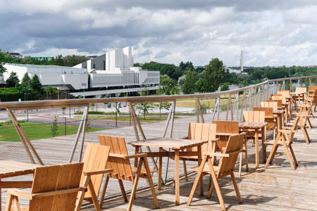 Helsinki, Finland - July 1, 2020: The terrace of the Oodi library. View of the Finlandia Hall.