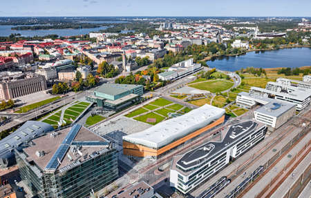 Aerial view of the autumn Helsinki cityscape. Landmarks on the picture: Oodi library, Sibelius Academy, Finlandia Hall, The National Museum, Parliament, Toolo bay.