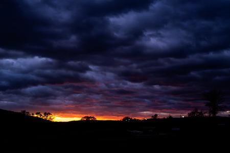 sunset in cold and rainy november - dark tones