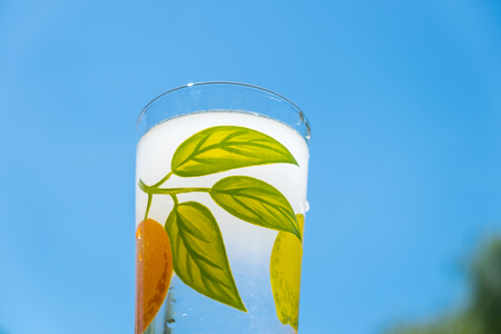 glass of chlorinated tap water in hot summer, blue sky in background, close up Stock Photo