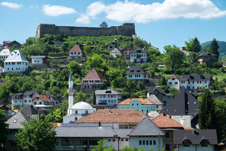 medieval city with fortress and white mosque, Bosnia and Herzegovina, summer sky Stock Photo