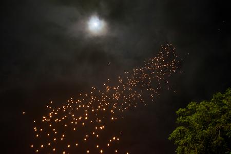 Waisak - Vesakha - Vesak celebration, Buddha birth, enlightment and death, lantern-flying before sunrise at Borobudur stupa, with the Moon and greenery
