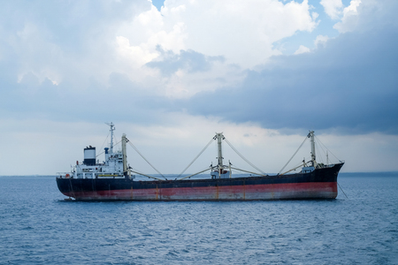 Cargo ship on the tropical java sea