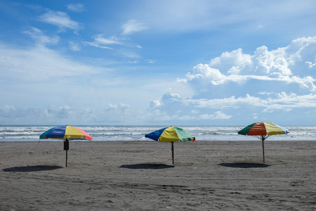 Colorful parasols at the Parangtritis beach Java island Indonesia afternoon Imagens