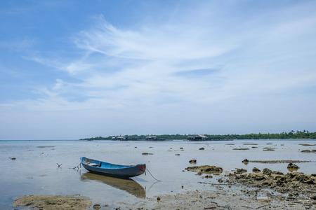 blue drift boat at low tide on Karimunjawa island