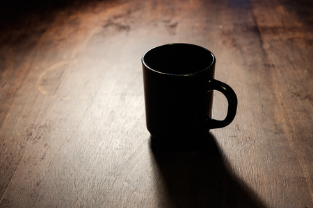 black coffee cup in spot light