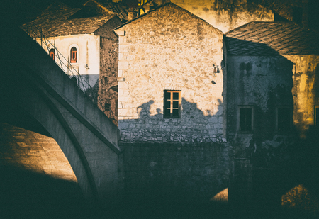 people silhouette on medieval stone house wall, Mostar, Bosnia and Herzegovina, vintage, concept Imagens - 99246311