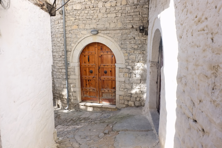 medieval street with wooden door in Berat city, Albania Imagens