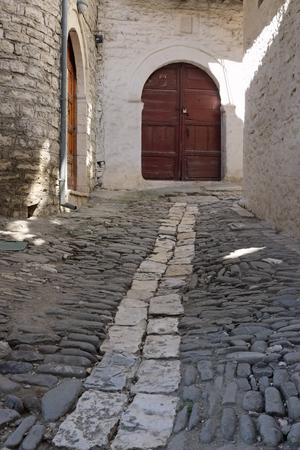 medieval street with wooden door in Berat city, Albania, vertical Imagens - 99284268