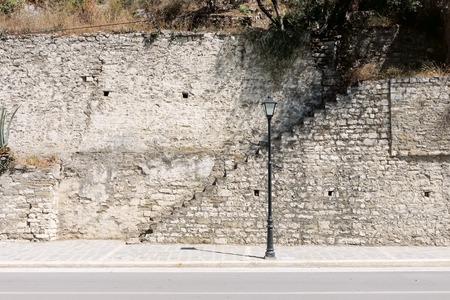 lamp pos, sairst and medieval stone wall in Berat city, Albania
