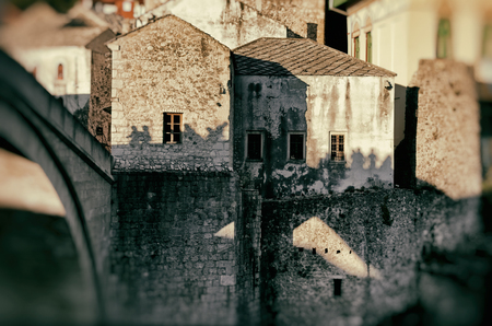 people silhouette on medieval stone house wall, Mostar, Bosnia and Herzegovina, vintage, concept