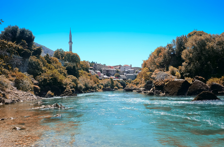 mostar city view, river side, medieval, mosques, retro