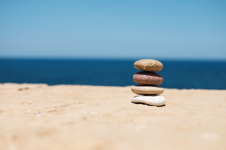 stack of pebbles on right symbolizes balance and harmony