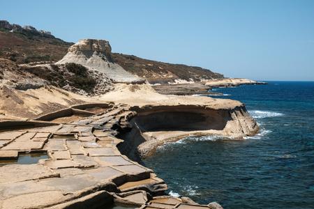 salt pans and rocks at Gozo islands, Malta Imagens
