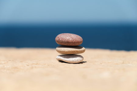 stack of pebbles in the middle symbolizes balance and harmony Stock Photo