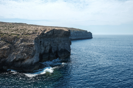 high cliffs and the blue mediterranean sea at Gozo island