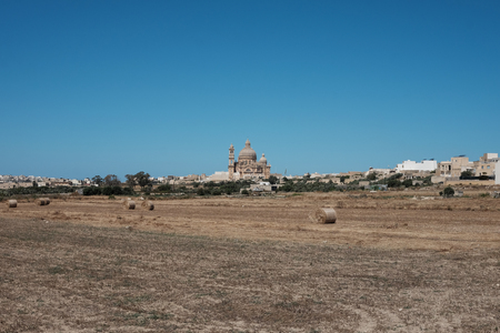 Gozo island landscape with agricultural field and church Imagens - 102136426