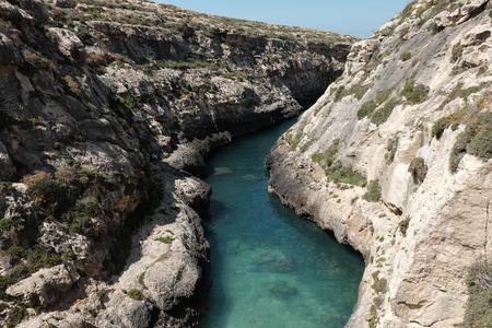 Malta 2018 - blue lagoon between high cliffs at Gozo island, Wied il Ghasri