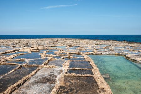 salt pans at the sea near to Marsalforn, Gozo island, Malta Imagens - 102146744