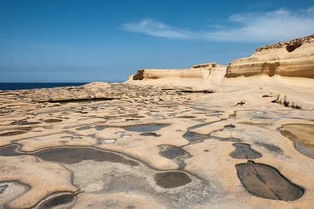 yellow sandstone rocks at the sea, Marsalforn, Gozo island, Malta