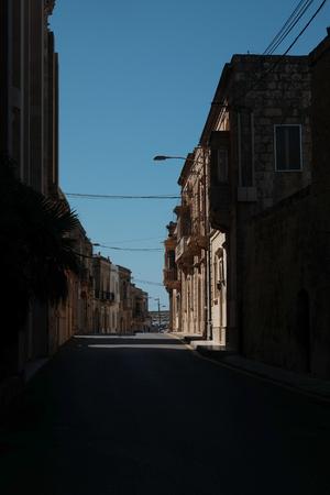 morning sun lights the traditional maltese houses - dark tones Imagens