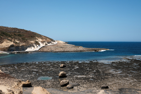 sinuous road at the sea - Marsalforn, Gozo island, Malta