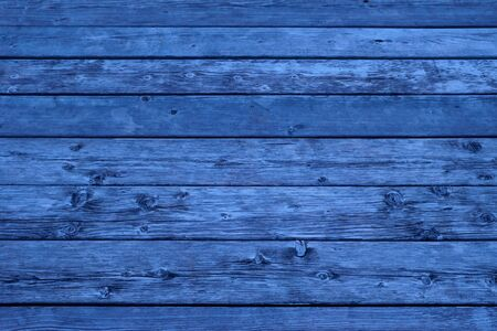 blue wood weathered background with knots and nail holes, close up