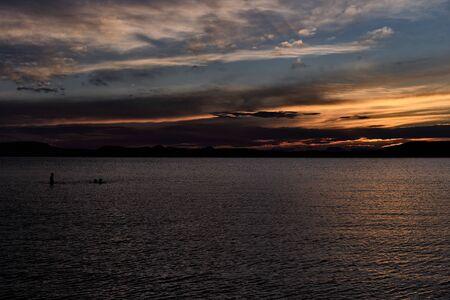 lake Balaton sunset, people silhouette, Plattensee - dark tones