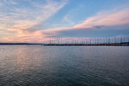 marina and sailboats at lake Balaton at sunset, Plattensee, Hungary Imagens