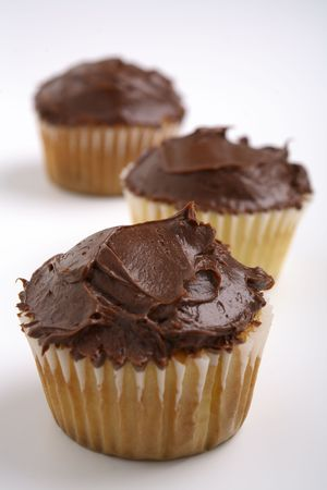 Cioccolato vaniglia ghiacciato Cupcakes Archivio Fotografico - 784758