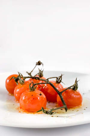 Roasted Cherry Tomatoes on the vine with olive oil, sea salt and black pepper. A delicious start to any meal.