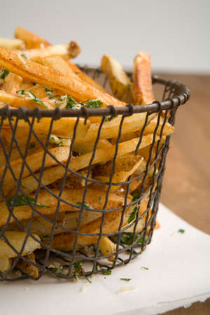 indulgent: Fresh home cut french fries with fresh parsley and parmesan cheese